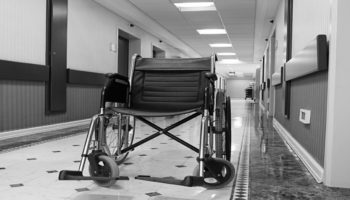 Fotolia_41105694_S - wheelchair in corridor -blkwht_1540