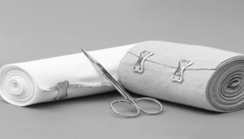 Two rolls of secured elastic bandage and scissors.